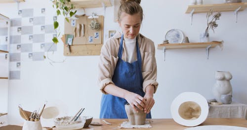 A Woman Molding a Clay Pot