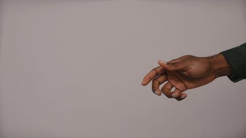 Hands Exchanging Money