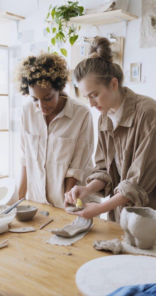 Women Shaping a Clay