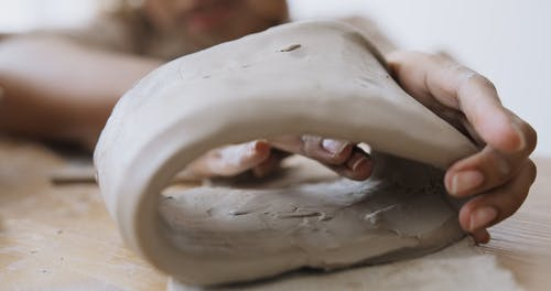 A Person Shaping Clay Pot