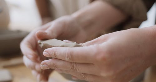 A Person Shaping a Clay