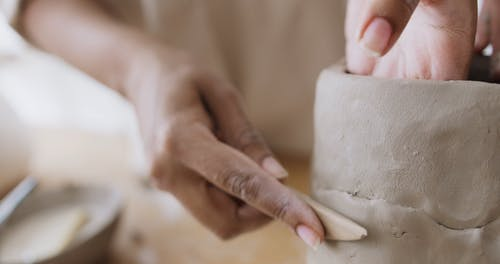 People Molding a Clay