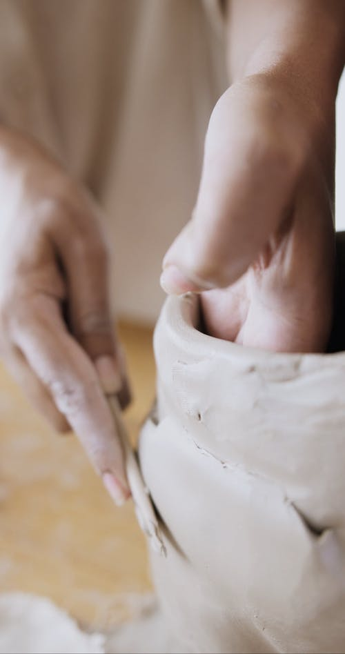 Close-Up Video of Hands Making a Clay Pot