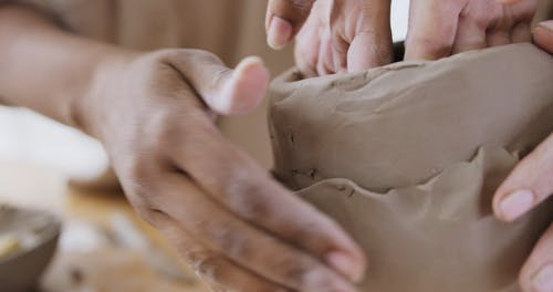 A Person Making a Clay Figurine