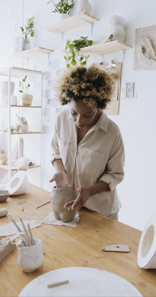 A Woman Sculpting Clay