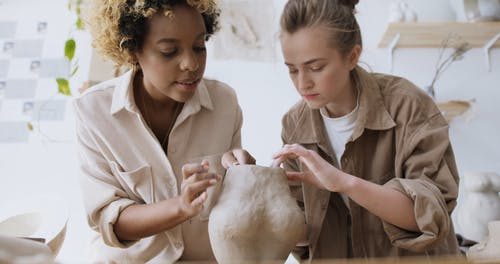 Women Molding a Clay