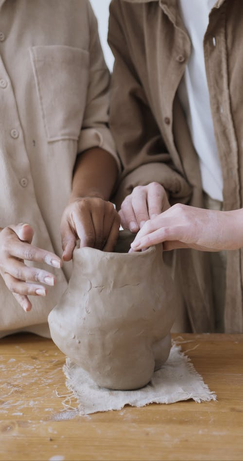 Two People Molding a Clay Pot