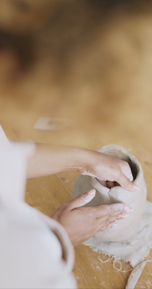 A Person Making a Clay Pot
