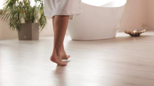 Woman Tiptoeing in the Bathroom