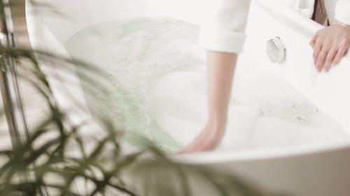 Woman Preparing her Bathtub
