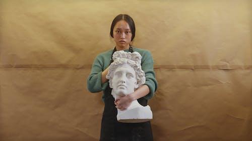 Artist Holding a Statue