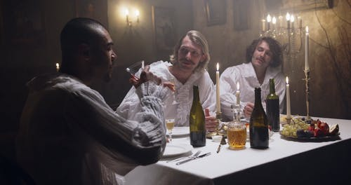 Renaissance Men Talking and Drinking at the Table