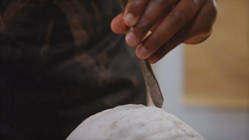 Man Sculpting A Statue