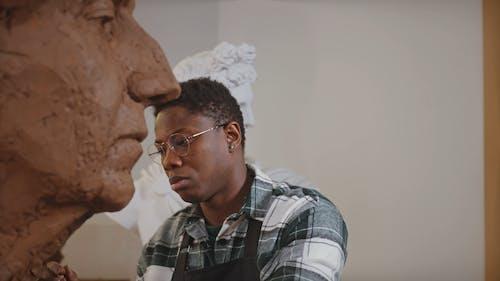A Man Looking at a Sculpture