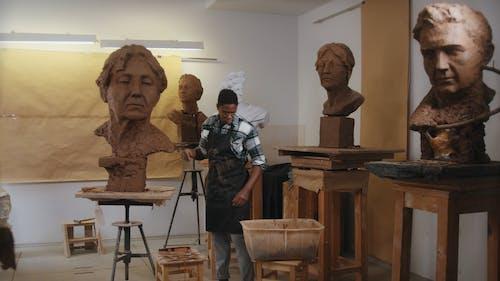 A Man Working on a Sculpture