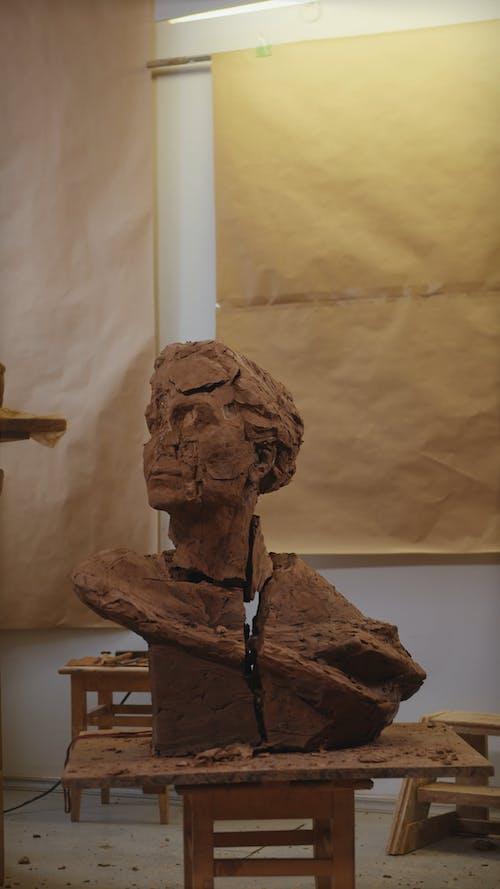 Artist Breaking a Sculpture