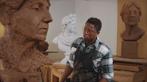 Artist Looking at Sculpture