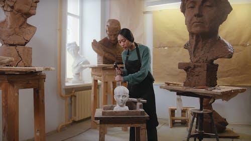 Artist Carving a Sculpture