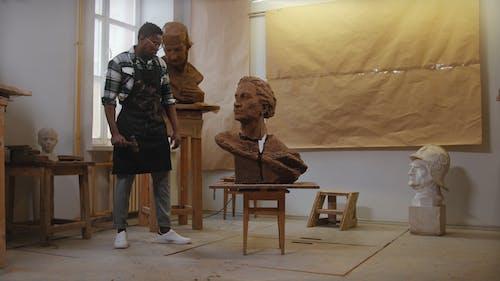 A Man Hammering a Sculpture