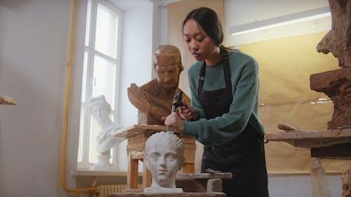A Woman Making a Sculpture