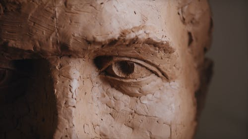 Close Up View of Statue Made of Clay