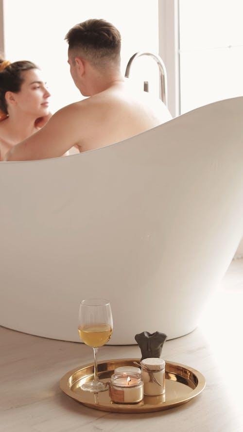 Couple Sitting in the Bathtub