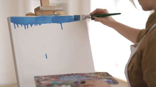 Woman Painting In A White Board