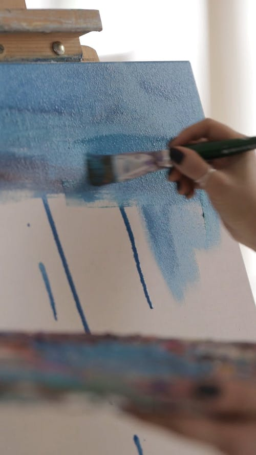 A Woman Painting on a Canvass