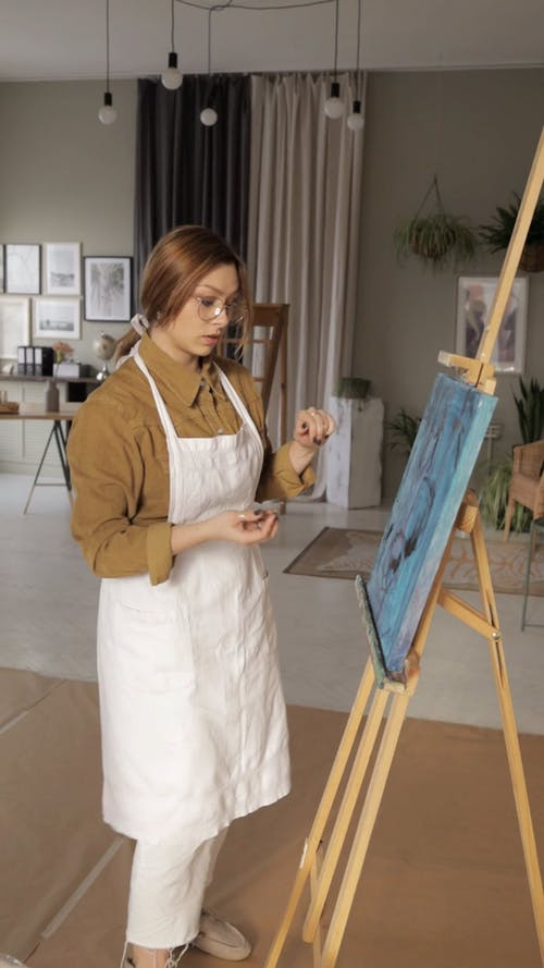 Woman Working In A Painting
