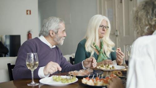 People Talking While Eating