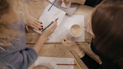 Women Writing While Sitting