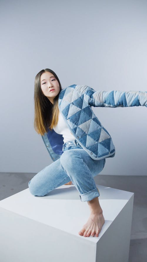 A Woman Wearing a Denim Jeans