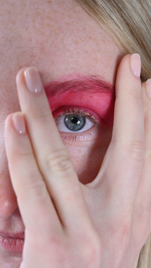 Half Covered Female Face With Pink Makeup