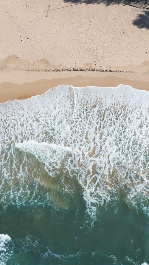 Top View of Sea Waves Crashing on Seashore