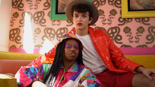 Two People Wearing Bright Colored Clothes