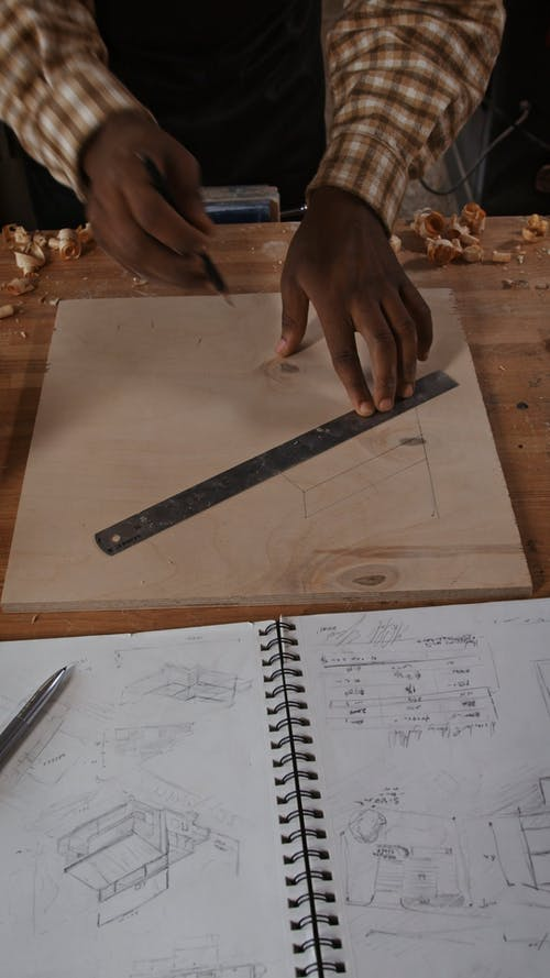 A Wood Worker Sketching his Ideas