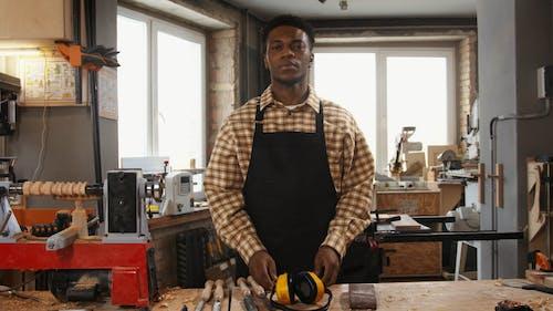 Carpenter in a Worshop