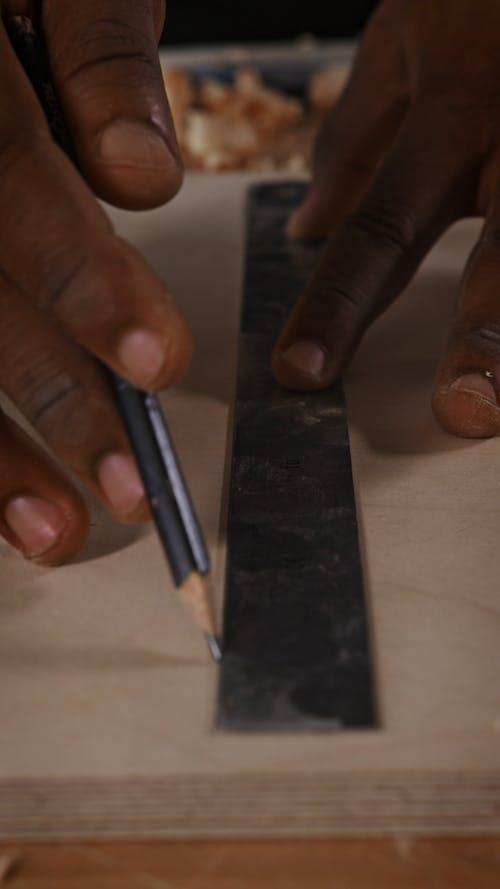 Carpenter Making a Design
