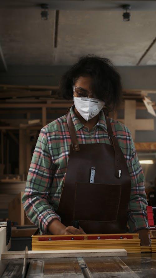 A Carpenter Cutting a Piece of Wood