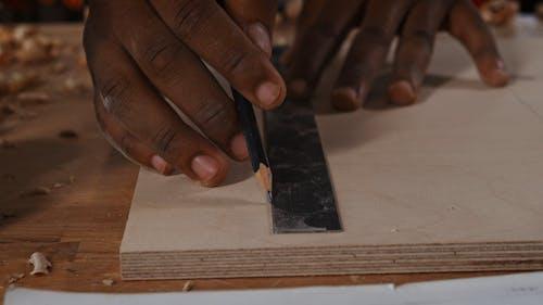Carpenter Designing on Wood