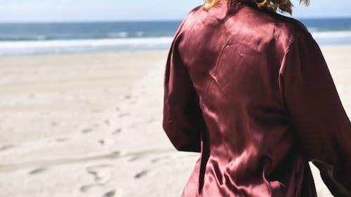 Woman Doing a Ritual on the Beach