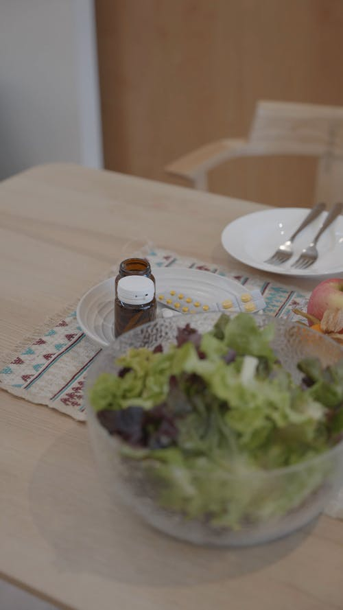 Salad And Fruit Over Dining Table