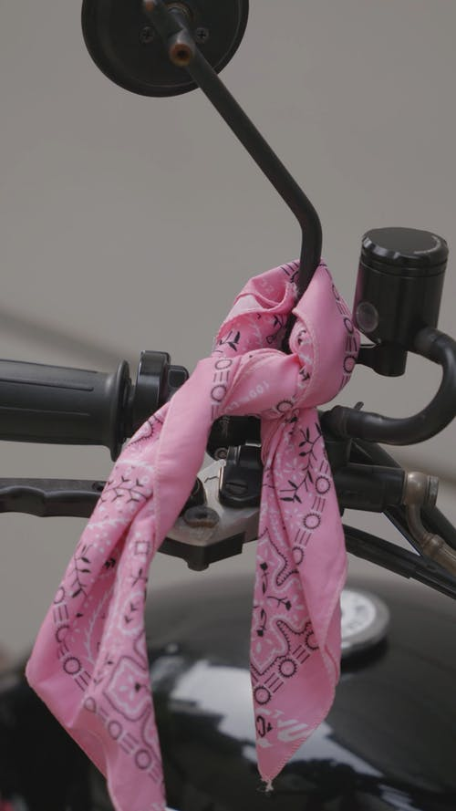 Pink Bandana Tied to Motorcycle Side Mirror