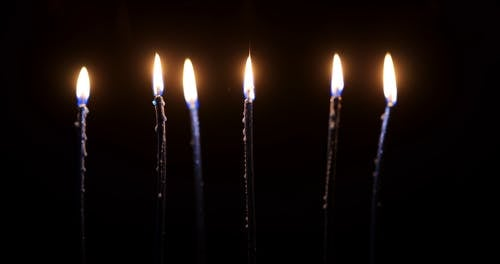 Lighted Candles in a Dark Background