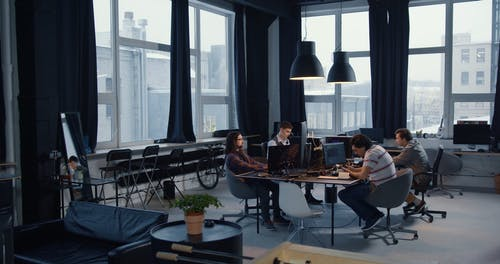 Four Men Working in an Office