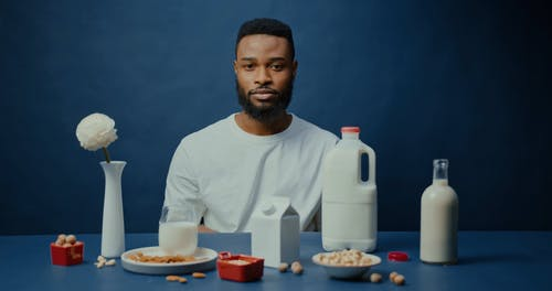 Man Drinking Almond Milk