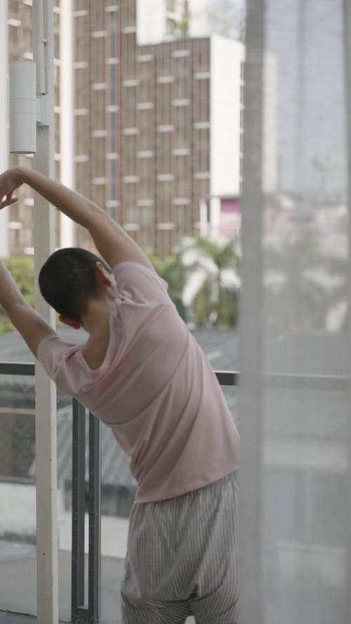 A Person Stretching on a Balcony