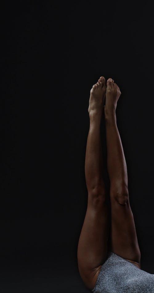A Woman Crossing Her Legs