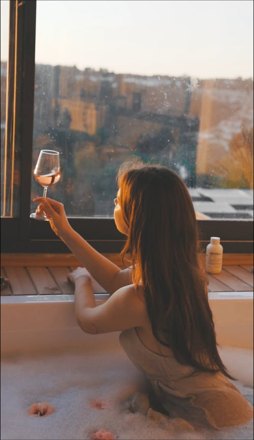 A Woman Holding a Glass of Wine