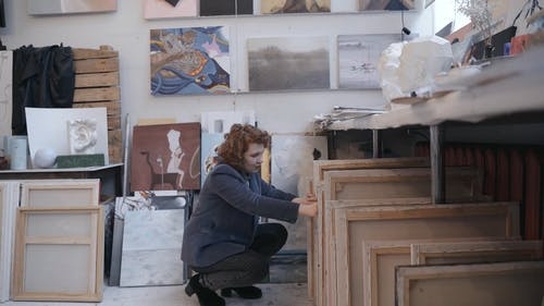 A Woman Checking the Art Work